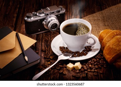 still life grain coffee sugar retro camera croissant sugar pencil and notebook on wooden background