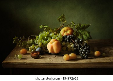 Still life with grapes, apples and plums