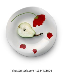 Still life with half of sweet ripe pear on the beautiful plate against white background. Selective and soft focus.