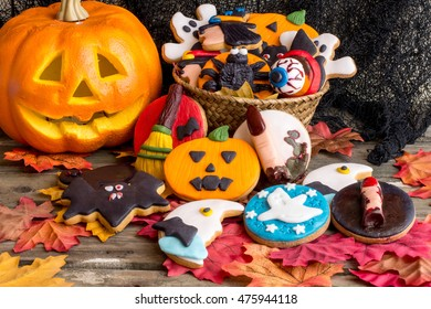 Still life of halloween homemade cookies on autumnal foliage and basket