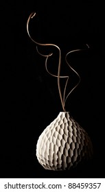 Still life with handmade modern vase isolated on a white background.