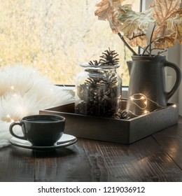 Still life in home interior. Cozy winter or autumn cup of coffee at home warm fluffy furskin, garland, swedish hygge concept.