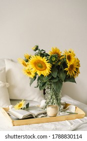 Still life in home interior of living room. Sunflowers, Coffee and open book. Read, Rest. Cozy Home