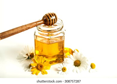 Still life of honey, tableware, flowers, nuts, close up