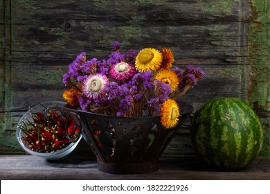 Still Life hoto of Red Peppers,Dried Flowers in Iron Vase With Watermelon