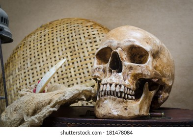 Still life with human skull and lantern