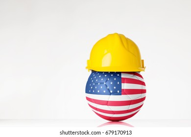 still life image of football wearing a hard hat with the USA flag  superimposed on the football