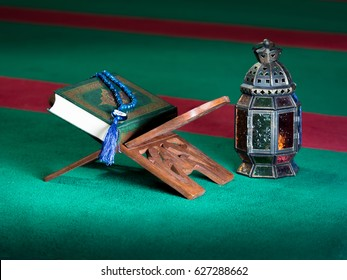 still life image of the Quran. The Quran literally meaning 'the recitation' is the central religious text book of Islam, which Muslims believe to be the verbatim word of God or Allah