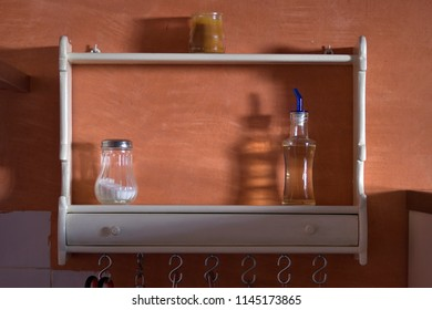 Still life of kitchen cabinet with salt oil and candle