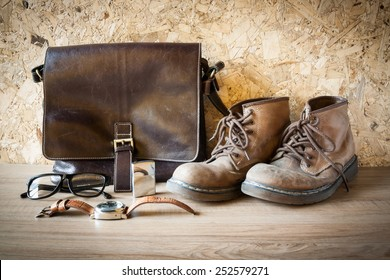 still life with leather bag , boot , glasses , watch and Lighters om wood background look vintage