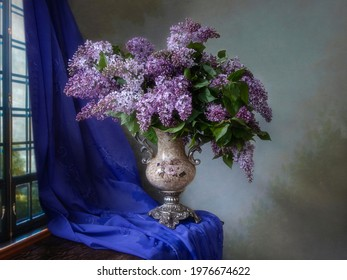 Still life with a luxurious bouquet of lilac in a vintage vase