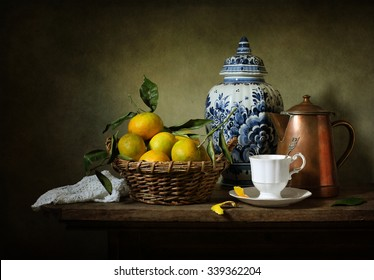 Still life with mandarins and a Delft vase (textured for artistic effect)