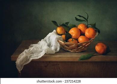 Still life with mandarins and drapery
