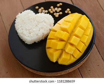A still life of a melon cut into squares with a heart-shaped portion of sticky rice, Thailand
