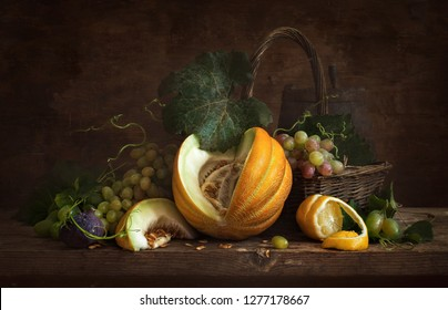 Still life with melon, lemon and grapes in the style of Dutch masters