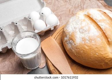 still life with milk, eggs, bread