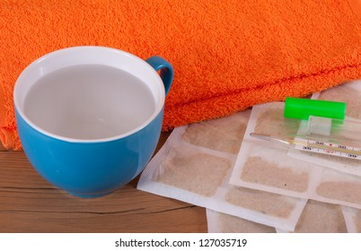 still life from mustard leaf with towel and cup