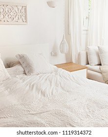 Still life of neutral empty home deco double bedroom, cozy and inviting, clean white bed interior design, indoors. Comfortable stylish hotel room, homey perfect tasteful simple decoration, lifestyle.