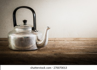 the still life old aluminium kettle. vintage tone