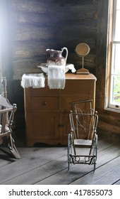 Still life of old antique wash basin and dresser in a log cabin.