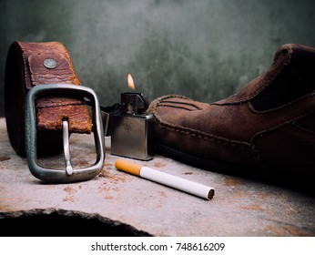 Still life old Leather shoes , belt with cigarette and lighter. Old fashion men style.