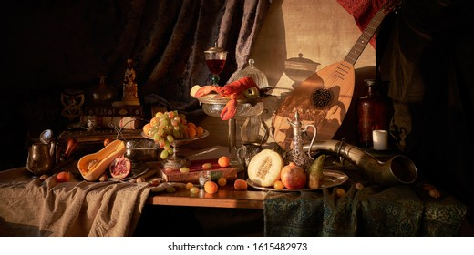 Still life in old masters style with lobster, glass of wine, silver dishes, fruits, guitar lute and hunting horn.             - Shutterstock ID 1615482973
