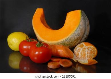 still life with orange vegetables