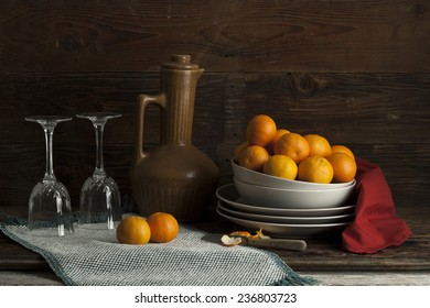 Still life of oranges and glasses.