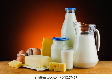 still life with organic dairy products, milk, cheese, butter and eggs