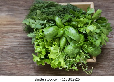 still life organic fragrant herbs on a wooden table