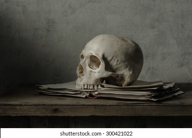 Still life painting photography with human skull and book