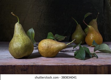 still life with pears on a wooden table