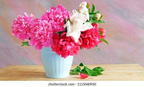 still life with peony flowers bunch and strawberries