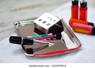 Still life of permanent makeup tattooing machine and pigments
