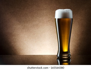 Still life photo of light lager beer in high glass.