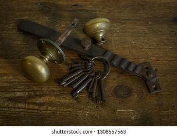 Still Life photograph of Keys and door furniture.