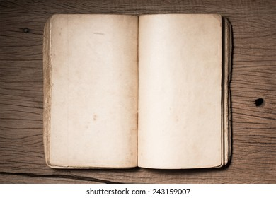 still life photography :  blank opening old book on old wood plank