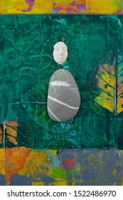 Still Life Photography garden face and stone on green abstract nature background.