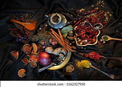Still life photography of Lemon, ginger, chili, lemongrass, galangal, kaffir lime leafs on table, Thai herbs, the best materials for cooking healthy Thai food. Healthy food concept. Flat layout shot.