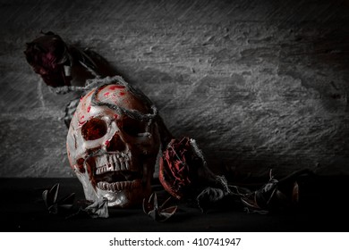 Still life photography with skull and roses in dark tone image