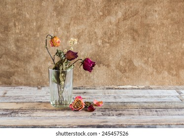 Still life photography : Withered rose in glass on art dark background
