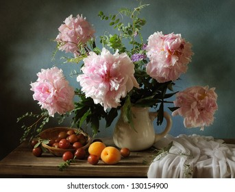 Still life with pink peonies and apricots