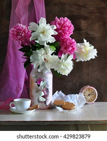 still life with pink and white peonies