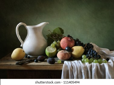 Still life with a plate full of fruit