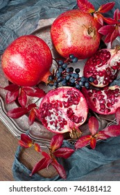Still life with pomegranates  on dark background, top view