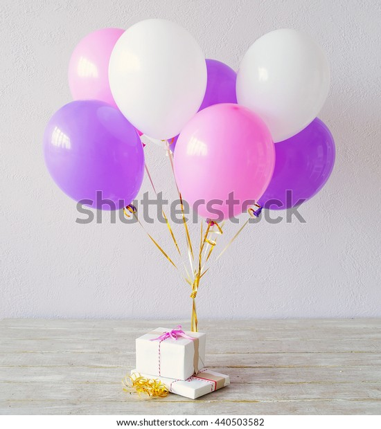 Still life with present boxes and multicolored balloons