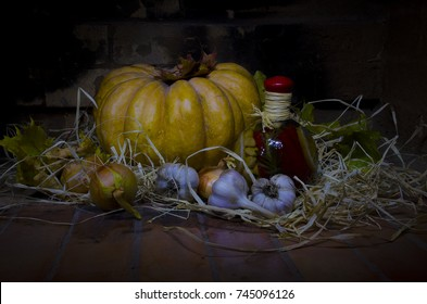 still life pumpkin with garlic onion and bottle