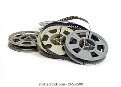 still life of random group of dirty, old 8mm cine film and reels; isolated on white ground
