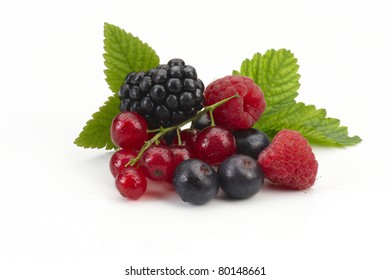 Still life with raspberries blueberries blackberries and currants