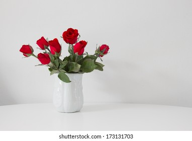 still life of red rose in ceramic vase